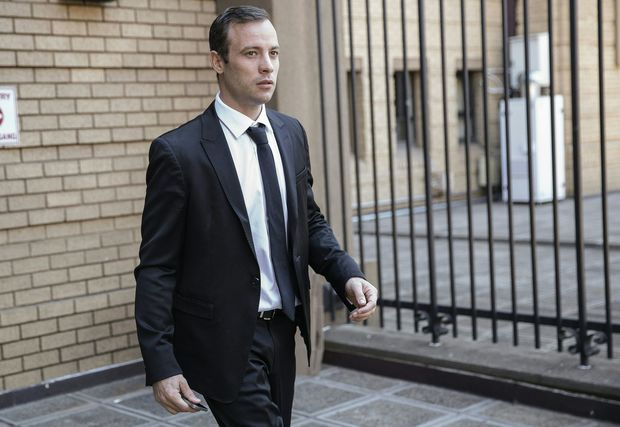 Oscar Pistorius leaving Pretoria High Court on 18 April 2016 after his murder case hearing was postponed.