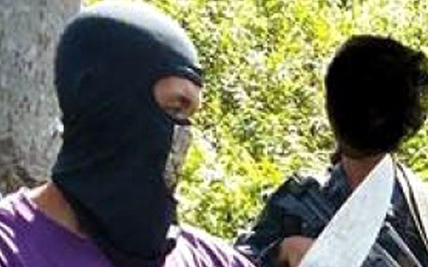 This undated photo is reported to show militants with the Philippines-based Abu Sayyaf.