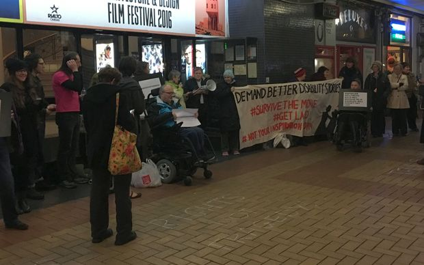 People outside the Embassy Theatre in Wellington protest the movie 'Me Before You'.