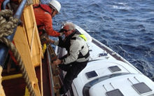 The surviving trio of the stricken yacht Platino is safely back in New Zealand and heaping praise on the crew of their rescuers.