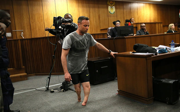 Paralympic athlete Oscar Pistorius walks in the courtroom without his prosthetic legs during his resentencing hearing for the 2013 murder of his girlfriend Reeva Steenkamp at the Pretoria High Court on June 15, 2016.