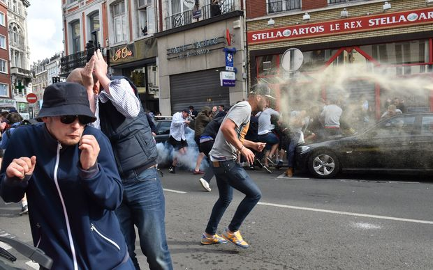 Football fans clash with police officers in central Lille.