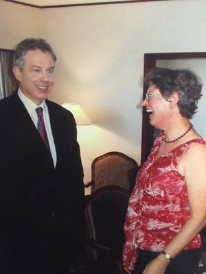 Tony Blair and Eva Radich share a laugh post-interview on RNZ National's Nine to Noon in 2006