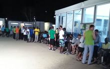 Residents of the Manus Island processing centre queue for food.