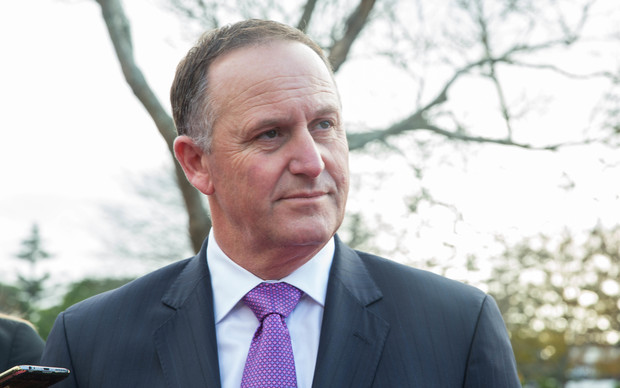 Prime Minister John Key talks to media outside of Rainbows End. 16 June 2016.
