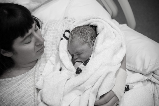 A photo of Nicola Devine in bed with her  son, Tanner, who was still born.