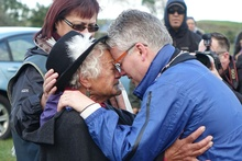 New Plymouth mayor Andrew Judd is embraced by Parihaka elder Te Whero o te Rangi Bailey after the peace hikoi entered Parihaka.