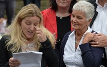 Jean Leadbeater (L), the mother of murdered Labour MP Jo Cox, listens as Kim (L), Jo's sister, reads a tribute in Birstall, northern England.