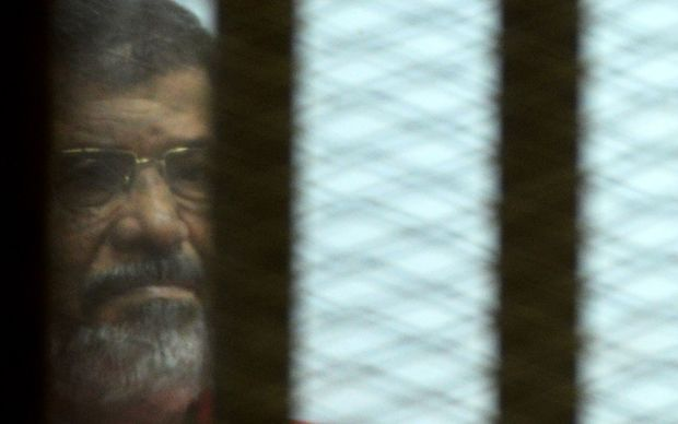 Egypt's ousted president Mohamed Morsi during his trial on espionage charges in Cairo on June 18, 2016.