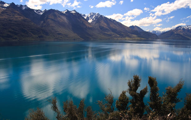 Scenic view of Lake Wakatipu with Southern Alps in background near Queenstown, South Island, New Zealand.