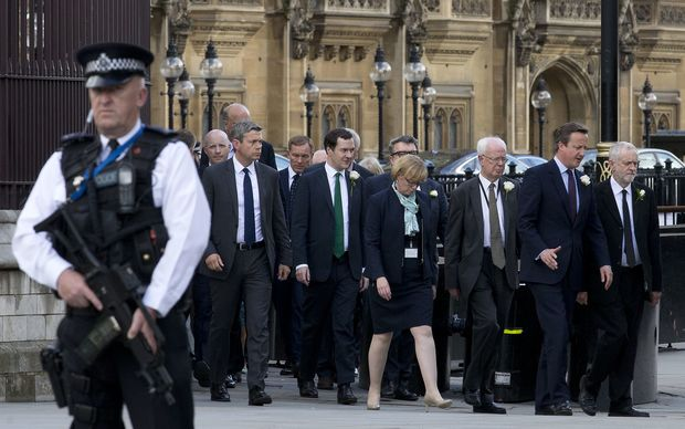 UK MPs leave the Houses of Parliament for a service of remembrance after a special session to honour murdered MP Jo Cox.