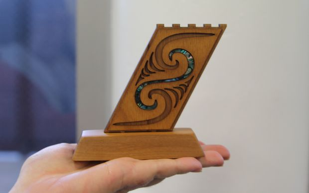 One of the inmates at Arohata Prison holds an award she received from the drug treatment unit.