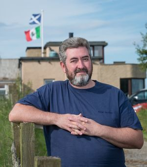 David Milne's home next to Trump International Golf Links course is flying two flags - the Scottish Saltire and the Mexican flag.