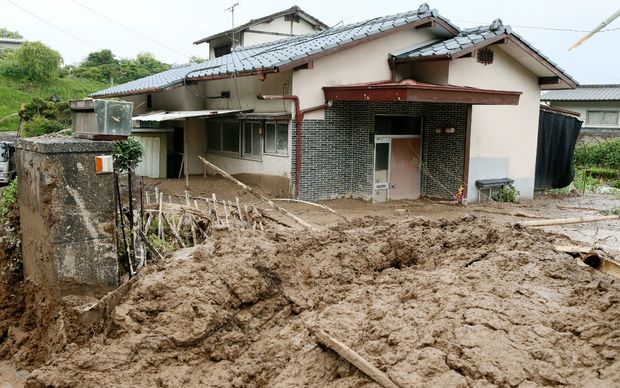 Several houses in Kumamoto in southern Japan have been inundated by mudslides after heavy rain.
