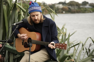 Lawrence Arabia (James Milne) performs next to Lake Pupuke.