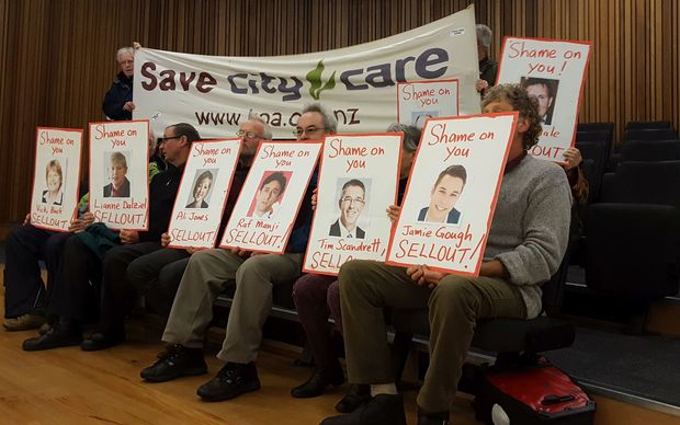 A small group protested planned asset sales by the Christchurch City Council at its meeting today.