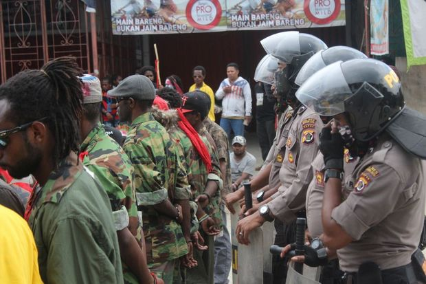 West Papuan demonstrators tightly monitored by Indonesian police.