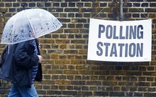 Britons go to the polls on a rainy June day to vote on whether Britain should stay in or leave the EU.
