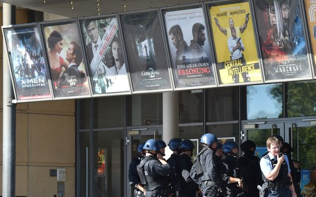 Police forces stand in front of a cinema where an armed man barricaded himself in Viernheim, southern Germany.