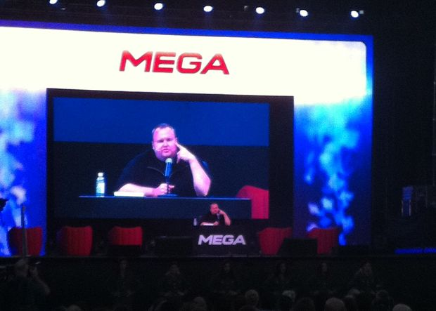 Kim Dotcom holds a news conference at Sunday's launch party.