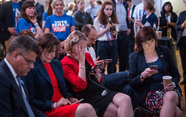 Supporters of the 'Stronger In' Campaign react as results of the EU referendum are announced at a results party at the Royal Festival Hall in London early in the morning of June 24, 2016.