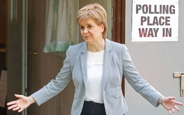 Scotland's First Minister and Leader of the Scottish National Party (SNP), Nicola Sturgeon, reacts as leaves after voting at a polling station at Broomhouse Community Hall in east Glasgow, on June 23, 2016,
