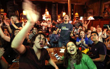Supporters of the Leave campaign EU referendum in the United Kingdom celebrate to see the lead for them at a pub in London on June 24, 2016.