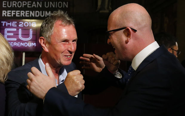 UKIP MEP Paul Nuttall, right, and Conservative MP Nigel Evans celebrate the likely victory of 'Leave'.