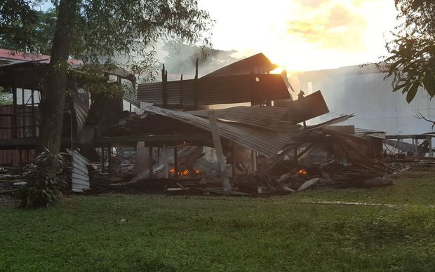 The remains of a building after it was set alight during violent clashes at the University of Technology in Lae, Papua New Guinea.