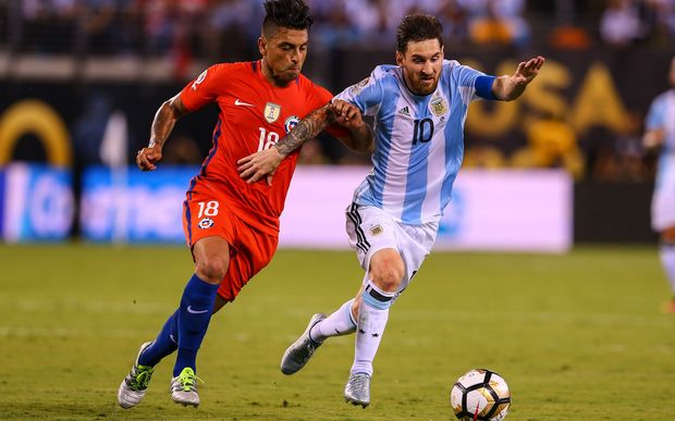 Argentina midfielder Lionel Messi (10) battles Chile defender Gonzalo Jara (18) during the second half of the Copa America Centenario Final between Argentina and Chile
