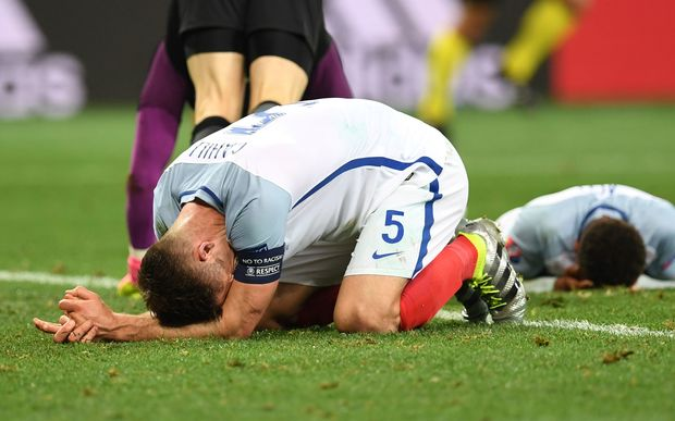 England's defender Gary Cahill reacts to the knock-out defeat.