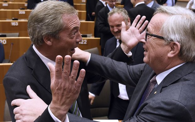 Nigel Farage (L) reacts as he meets European Union Commission President Jean-Claude Juncker at the EU headquarters in Brussels.