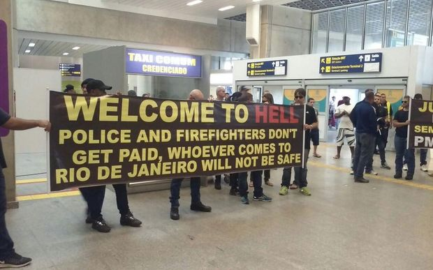 Police and firefighters protest poor conditions at Rio de Janeiro International Airport.