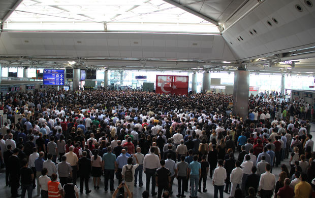 People attend a commemorative ceremony, held for the victims of the Istanbul Airport terrorist attack at International arrivals terminal in Istanbul, Turkey on June 30, 2016.