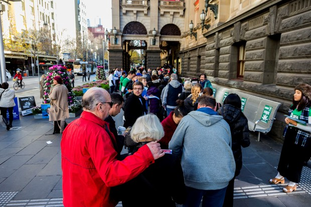 Voters line up to cast their vote at Melbourne town hall polling place on election day to determine all 226 members of the 45th Parliament of Australia in Melbourne, Australia on July 2, 2016.
