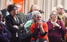 Supporters of Labor Party leader Bill Shorten look on as they follow results of the national election in Melbourne.