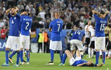 Italy players react during their Euro 2016 quarter-final penalty shootout defeat to Germany