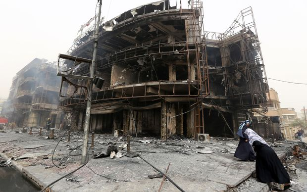 A damaged building in Baghdad at the site of a bomb attack claimed by Islamic State.