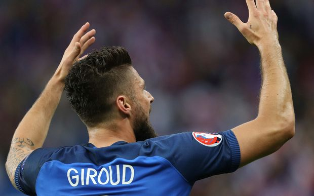 France's Olivier Giroud celebrates scoring a goal against Iceland.