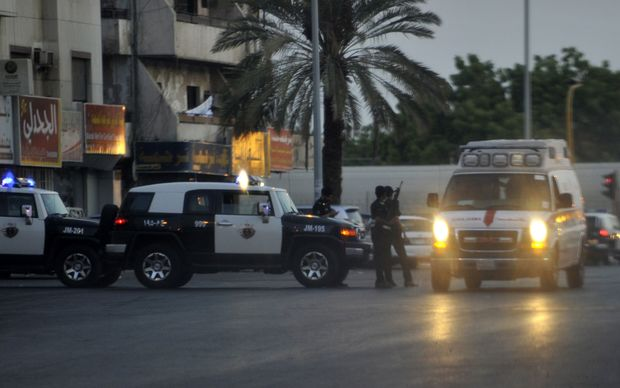 Saudi police stand guard at the site of a suicide attack near the US consulate in Jeddah.