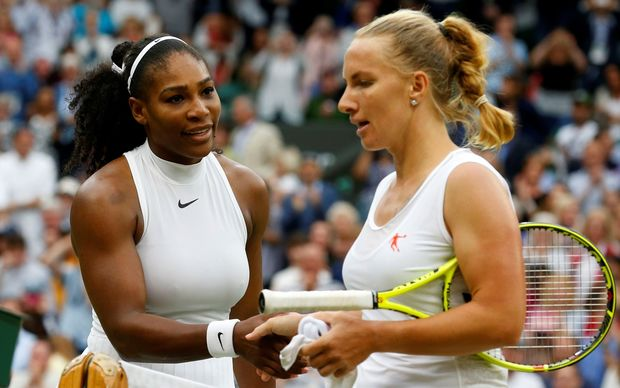 Serena Williams (L) shakes hands after beating Svetlana Kuznetsova on day eight of the 2016 Wimbledon Championships at the All England Lawn and Croquet Club in London, United Kingdom on July 04 2016. Lindsey Parnaby / Anadolu Agency 