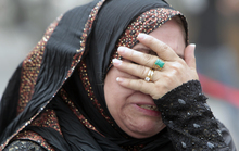 An Iraqi woman whose flat was destroyed in a massive bombing in Baghdad's Karrada neighbourhood reacts as she visits the aftermath of the attack.