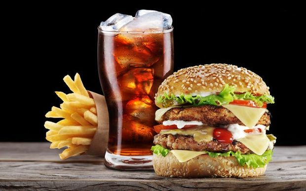 A burger, cola drink and fries.