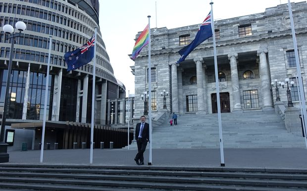 Labour MP Grant Robertson beneath a rainbow flag flying in Parliament grounds July 2016.