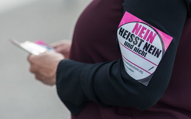 A woman with a sticker reading 'No means no' protests against certain contents of the reform of the law governing sexual offences in Berlin.