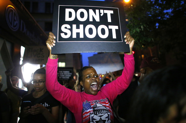 A woman holds a banner during a protest in support of the Black lives matter movement in New York.