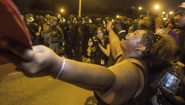Gina Key-Conrad pleads with Baton Rouge police in riot gear as they move in on the protesters over the Alton Sterling shooting on July 9, 2016 in Baton Rouge, Louisiana.