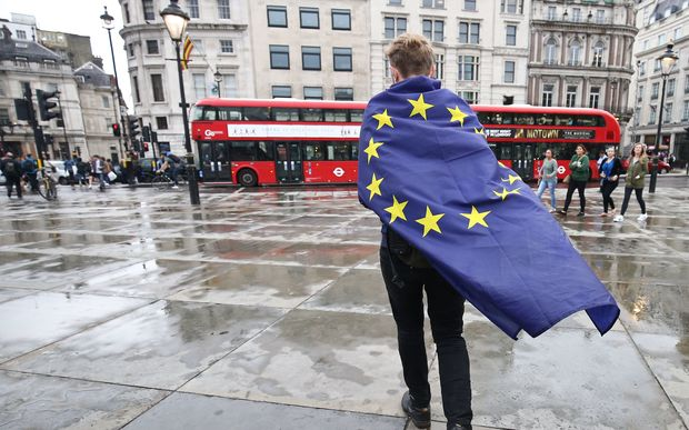 A demonstrator wrapped in a European flag leaves an anti-Brexit protest in Trafalgar Square in central London, 28 June 20016.