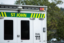 Close up of a St John ambulance on a residential street.