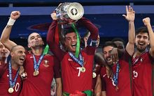 Portugal captain Cristiano Ronaldo holds up the winners' trophy as he celebrates with (from left) Ricardo Quaresma, Pepe, Joao Moutinho and Adrien Silva.